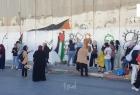 قوات الاحتلال تعتدي على فعالية لرسم صور الشهداء المحتجزة جثامينهم في أبو ديس
