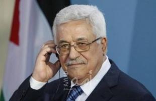 الرئيس عباس يعزي الشاعر والكاتب المتوكل طه بوفاة شقيقه
