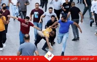 الأمن الفلسطيني يقمع مظاهرة تندد بإغتيال نزار بنات في رام الله - صور وفيديو