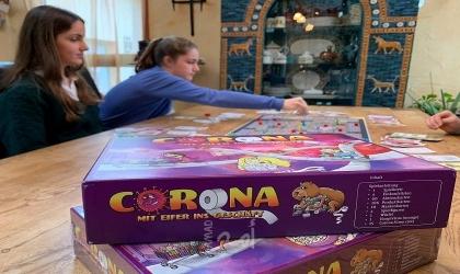 """""""فيروس كورونا"""".. لعبة اخترعتها أربع شقيقات ألمانيات تلقى رواجًا كبيرًا"""